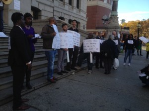 Some of the crowd at the rally, Kobi Dennis (far left)