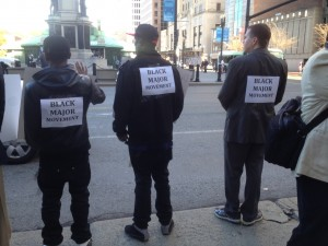 men with signs on back